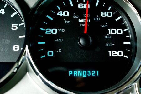 A speedometer and gauges on dash  Stock Photo