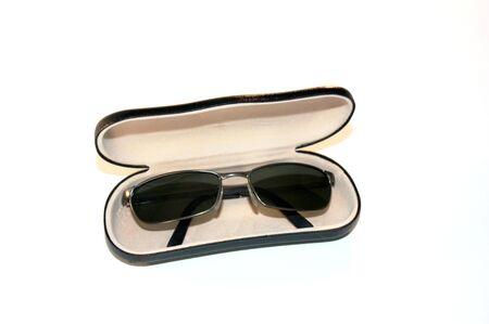 Sunglasses in an eyewear case.