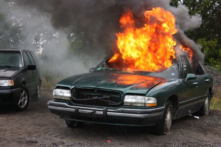 An auto engulfed in fire.