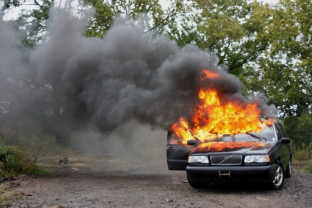 An automobile with the interior engulfed in fire
