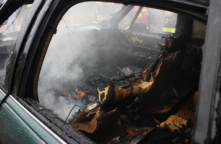 An auto interior after the fire is put out  Stock Photo
