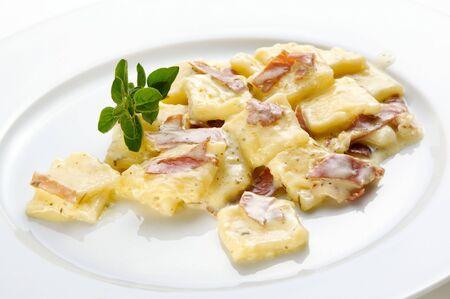 Pasta with prosciutto and cream sauce Stock Photo