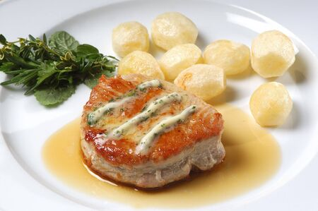 Tuna steak with butter and potato                         photo