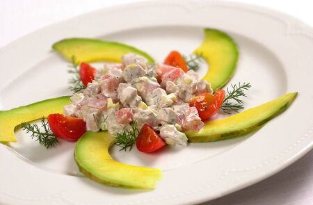 Chopped pork meat with avocado fruit