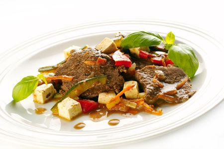 Horse steak with vegetables and tofu cheese Stock Photo