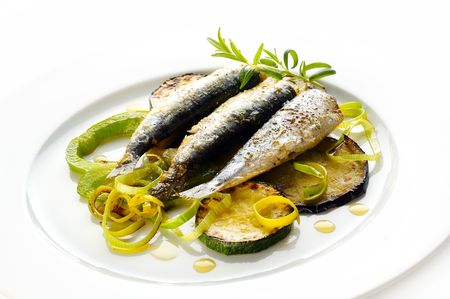 Grilled Sardines with zuccini and green onion Stock Photo