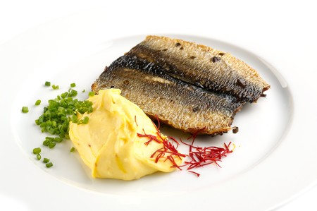 Grilled fish with mashed potatoes typical food from Chech republic