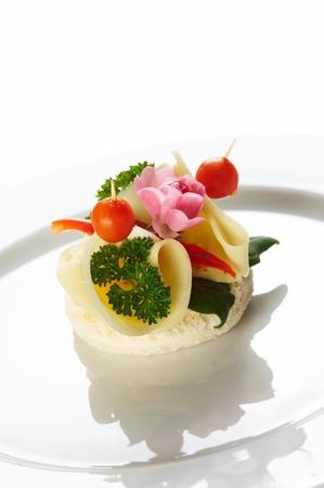 Single snack on white dish photo