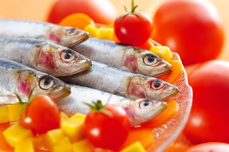 Group of sardines on different vegetables