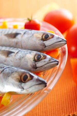 Group of mackerel fish on different vegetables Stock Photo - 3982730