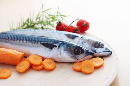Two mackerel fish with different vegetables photo