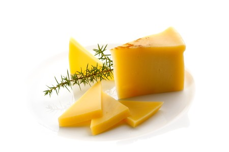 Sliced cheese on white plate