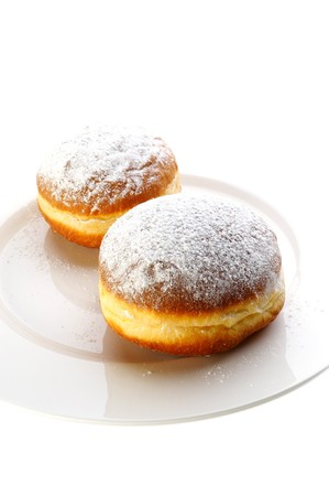 Two donuts covered with sugar powder Stock Photo