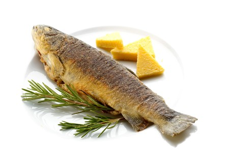 Fried trout with rosemary and corn groats