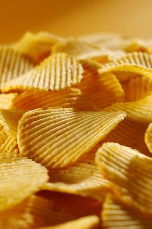 potato chips: Detail of fried potato chips Stock Photo