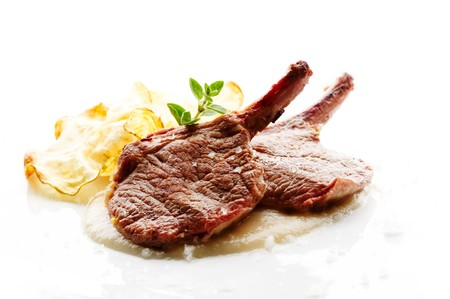 Grilled lamb cutlet on white plate