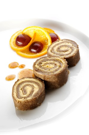 Rolled buckwheat cake filled with curd Stock Photo