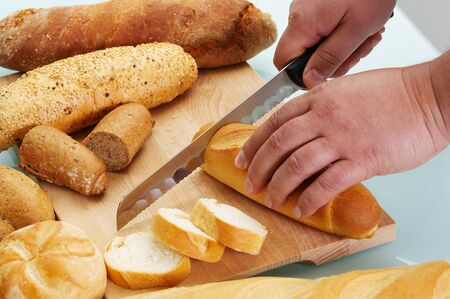 Cutting different sort of bread with knife Stock Photo - 4047982