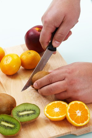 Cutting different fruits with kitchen knife