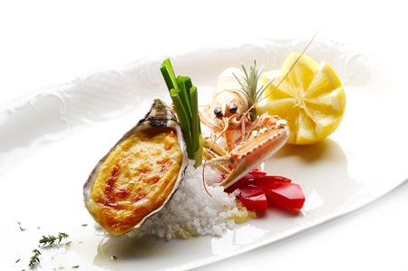 Grilled oyster with cheese and shrimpf Stock Photo