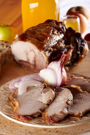 Baked pork meat cut in slices Stock Photo