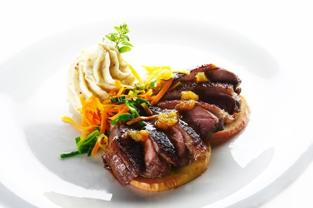 Roast duck with mashed potato cream and vegetable