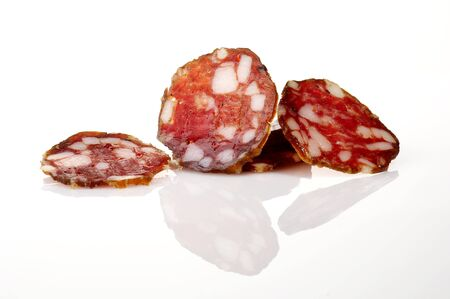 Slices of home made smoked salami isolated on white Stock Photo - 4065249