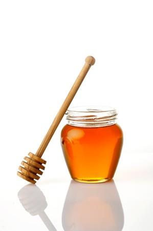 Pot of honey isolated on white