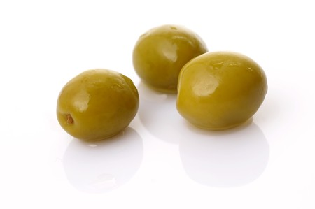 Green olives on white plate