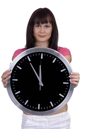 Emotive woman with oclock against a white background photo