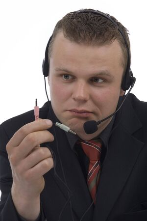 Man telephonist with hands-free phone against a white background photo