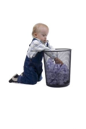 creasy: Boy playing with bin on white background