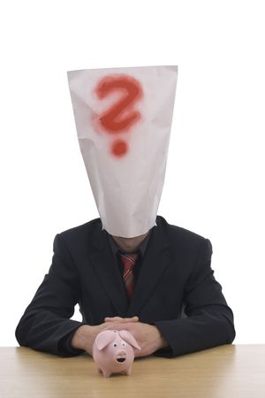 Man with moneybox and sack  on head whereat is red question - mark.  photo