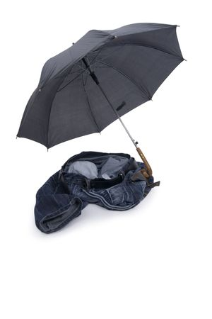 untitled key: Toss jeans with umbrella on white background. Stock Photo