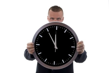 time sensitive: businessman with clock over white background