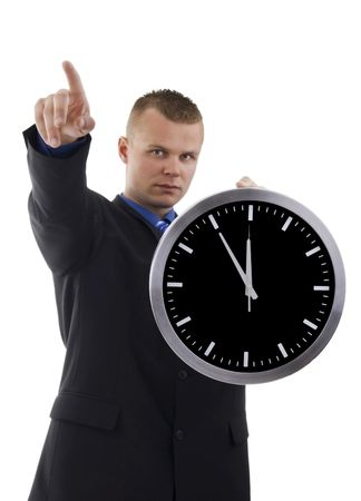 time sensitive:  Young dealer in oclock indicant finger against a white background