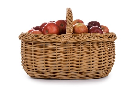 apples in wicker basket on white background. photo