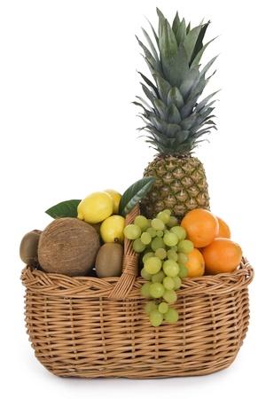 fresh fruit in wicker basket on white background. photo