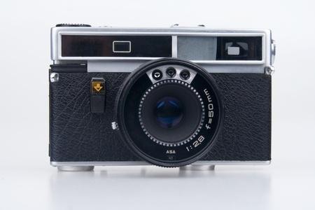 Old film camera.On white background. photo