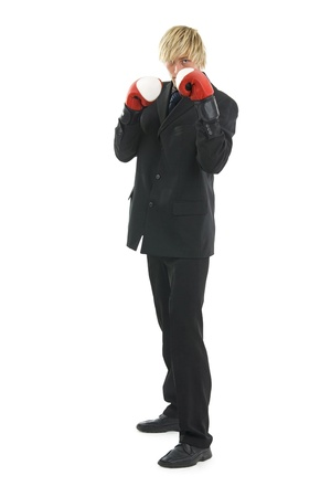 Man in glad rags and boxing glove on egg white background.Possible financial context.On white background. photo