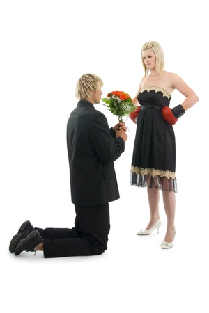 Man suppliant woman about forgiveness on white background.