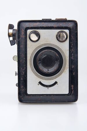 Old film camera.On white background. photo