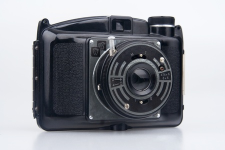 Old  photo camera.On white background. photo