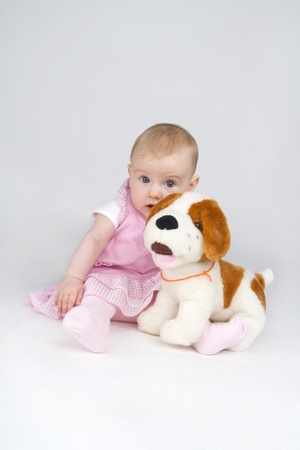 plushy: Dinky little girl with plushy doggy,on white background.
