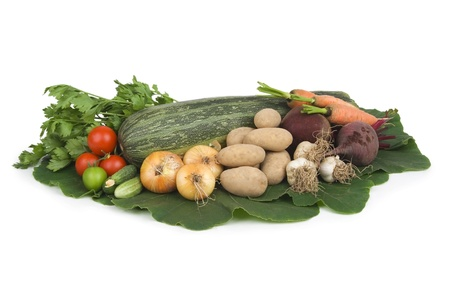 Variety of vegetables on white table.  photo