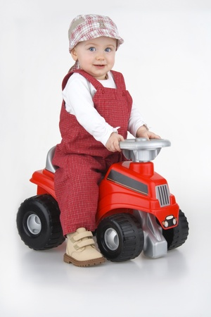 Child and toy - car,little girl governs toy - car on white background. photo