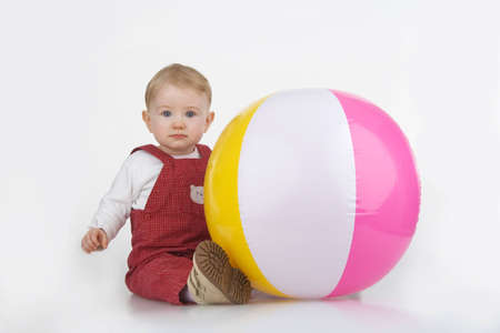 Child with beach ball on white background. Stock Photo - 12586345