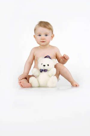Girl with plushy toy,on white backgroun. Stock Photo - 12586325