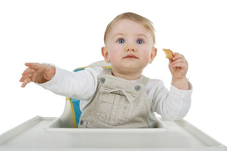 Infant biscuit on child photo