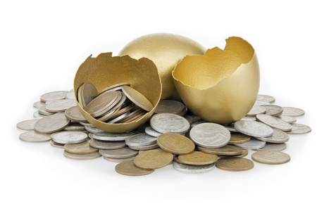 business symbols metaphors: Broken gold egg and old money,on white background.